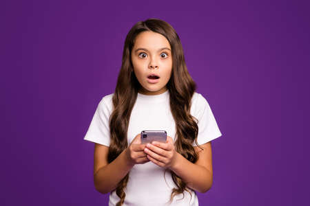 Close-up portrait of her she nice attractive lovely cute wondered astonished wavy-haired girl using cell 5g app reading news isolated on bright vivid shine vibrant purple violet lilac color background