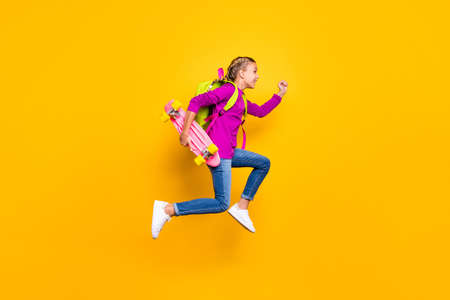 Full length body size view of her she nice attractive lovely glad purposeful cheerful cheery girl jumping running isolated over bright vivid shine vibrant yellow color background Standard-Bild - 140458867