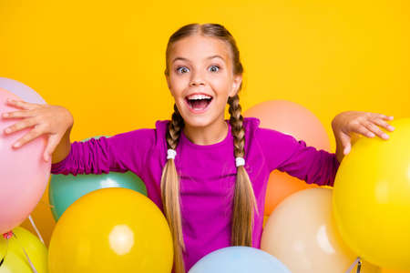 Close-up portrait of her she nice attractive lovely charming excited cheerful cheery girl among bunch balls isolated over bright vivid shine vibrant yellow color background Standard-Bild - 140458730