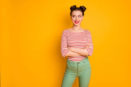 Portrait of her she nice-looking attractive lovely lovable winsome cheerful cheery girl folded arms looking aside copy space isolated over bright vivid shine vibrant yellow color background 版權商用圖片