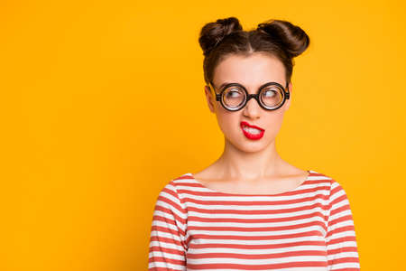 Closeup photo of evil mad crazy lady student grimacing grinning showing teeth look side wear circle freak specs striped red white shirt isolated bright yellow color background