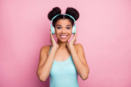 Close-up portrait of her she nice attractive lovely pretty charming cheerful cheery wavy-haired girl listening stereo sound radio melody isolated over pink pastel color background Stock fotó
