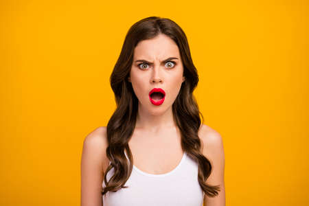 Closeup photo of funny pretty lady open mouth displeased facial expression listen bad news terrible situation wear white tank-top isolated bright yellow color background