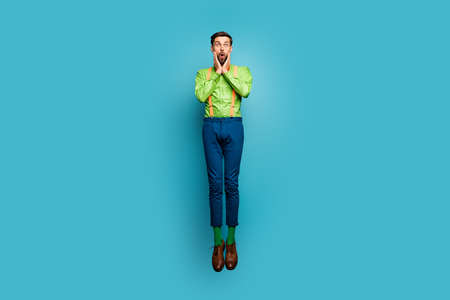 Full length body size view of his he nice attractive funky childish comic skinny amazed guy jumping black Friday isolated on bright vivid shine vibrant blue green teal turquoise color background Stockfoto