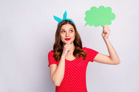 Interested minded girl hold green paper card speech bubble thoughts concept think decide decisions choose choice touch chin fingers wear vintage style outfit isolated grey color background