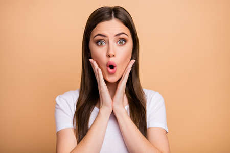 Portrait of astonished crazy girl look incredible wonderful novelty touch her face hands impressed scream wear stylish clothes isolated over pastel color background