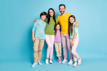 Full length body size view of nice attractive lovely charming ideal cheerful cheery family pre-teen kids mom dad embracing isolated on bright vivid shine vibrant blue color background