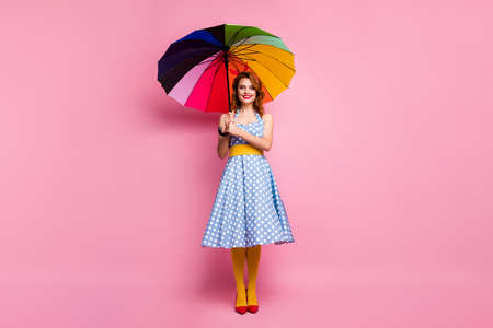 Full size photo positive sweet lovely nice lady fifties lifestyle hold bright parasol enjoy weather spring forecast weather season wear blue headband tights isolated pink color background