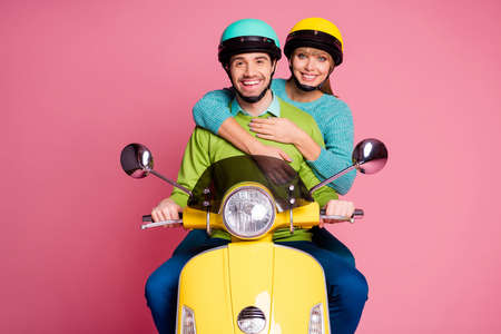 Photo of funny lady guy in love sit drive vintage yellow moped hugging visit foreign countries enjoy vacation together wear casual outfit headgear isolated pink color background
