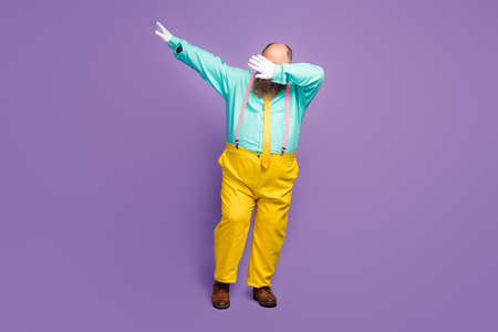Full body photo of cool funky crazy overweight man dance dancer dabber on night club wear teal pants, shine isolated over purple color background Standard-Bild