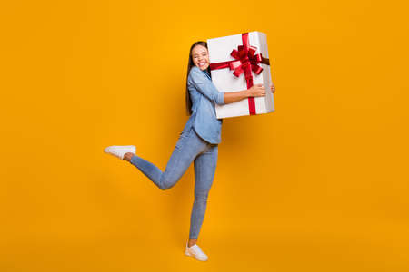 Full body photo energetic content girl celebrate 8-march 14-february day hug big white gift box red ribbon she get friends family wear good look shirt isolated bright shine color background Reklamní fotografie