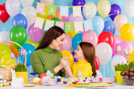 Portrait of nice attractive lovely sweet tender cheerful cheery girls preparing craftwork handmade holding hands spending day small little offspring sister