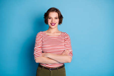 Photo of beautiful lady self-confident worker hands crossed toothy beaming smile short bob hairdo wear casual red white shirt green pants isolated bright blue color background