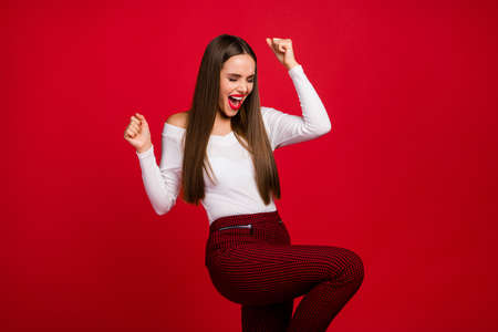 Portrait of delighted positive, rejoice lady celebrate beauty chic lottery win raise fists scream yeah wear good look clothes isolated over shine color background Фото со стока