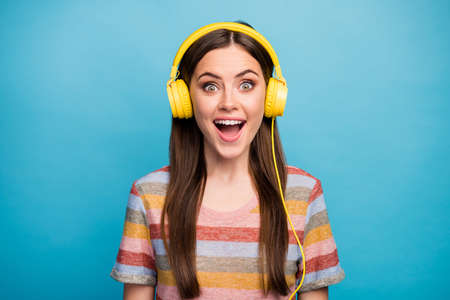 Close-up portrait of her she nice lovely lovable charming cute pretty cheerful cheery girl listening radio having fun time isolated on bright vivid shine vibrant blue color background Stock fotó