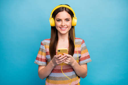 Close-up portrait of her she nice lovely pretty cute cheerful cheery girl listening radio retro nostalgic melody isolated over bright vivid shine vibrant blue color background