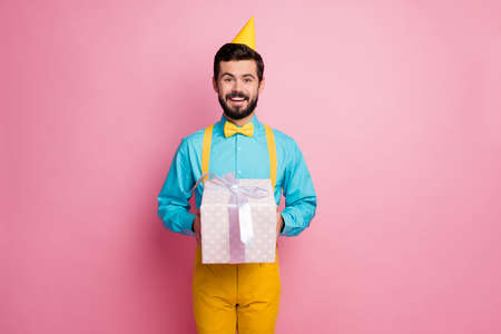 Portrait of his he nice attractive cheerful cheery bearded guy wearing festal look mint shirt holding in hands handling delivering giftbox tradition isolated over pastel pink color background