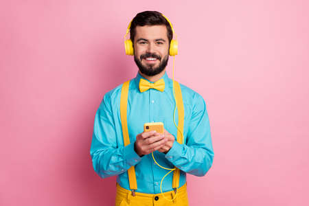Close-up portrait of his he nice attractive glad cheerful cheery bearded guy wearing mint shirt listening pop rock stereo sound soul jazz spending weekend isolated over pastel pink color background Stock fotó