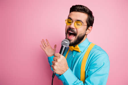Close-up portrait of his he nice attractive cheerful cheery bearded guy mc wearing mint shirt enjoying free time leisure singing karaoke single hit romance isolated on pastel pink color background