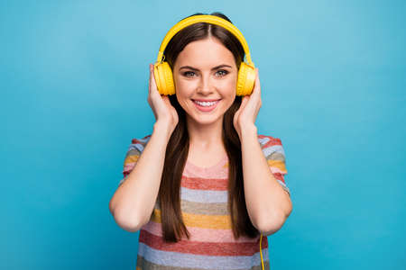 Close-up portrait of her she nice lovely charming cute winsome pretty cheerful cheery girl music lover listening radio new hit isolated on bright vivid shine vibrant blue color background