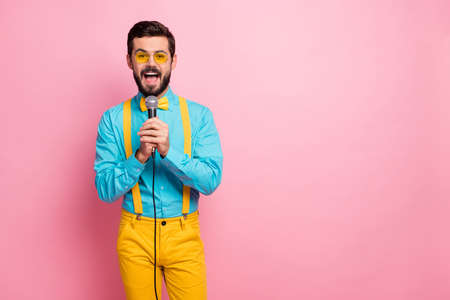 Portrait of his he nice attractive imposing glad cheerful bearded guy mc wearing mint shirt enjoying leisure singing karaoke single hit romance romantic song isolated on pastel pink color background