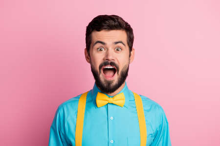 Close-up portrait of his he nice attractive amazed overwhelmed cheerful cheery bearded guy wearing festal mint blue shirt black Friday sale isolated over pastel pink color background