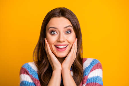 Close up photo of cheerful positive girl impressed by long waited present gift she get on birthday celebration wear sweater isolated over bright color background
