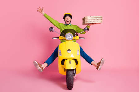 Portrait of his he nice attractive funky ecstatic overjoyed crazy cheerful cheery guy driving moped fooling having fun bringing pizza pie isolated over pink pastel color background