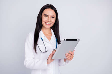 Photo of beautiful cheerful professional doc lady listen patient notice digital contract insurance e-book form wear stethoscope white lab coat isolated grey color background Stock Photo
