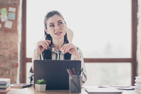 Close-up portrait of nice attractive dreamy smart clever minded girl creating solution solving deciding new plan IT project at modern brick loft industrial interior style work place station