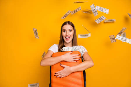 Crazy astonished girl embrace bag money earnings profit fall air blow fly win deposit credit bank lottery weekend trip scream wear hipster white t-shirt isolated bright shine color background