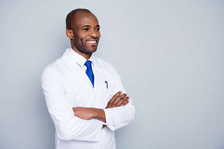 Photo of cheerful doctor dark skin guy virologist agent corona virus seminar conference listen colleagues research arms crossed wear white lab coat tie isolated grey color background