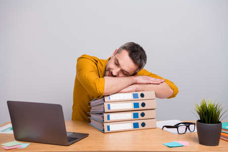 Portrait of marketer banker economist man work home have deadline start-up development project feel overworked sleep on pile stack folders wear trendy outfit isolated gray color background