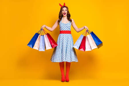 Full length photo crazy girl shopping center client buy hold bags impressed 50 off-sales wear blue skirt red headband tights stockings high-heels isolated bright color background Stockfoto