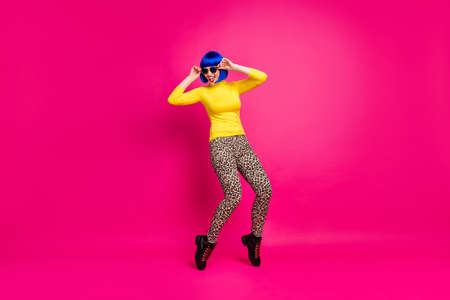 Full body photo of cool chilling lady students party rejoicing wear stylish retro specs yellow turtleneck blue wig footwear leopard trousers isolated bright shine pink color background