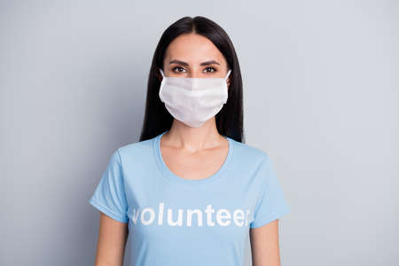Close-up portrait of nice attractive lovely content girl medic doc voluntary work worker job wearing protective mask isolated over grey pastel color background