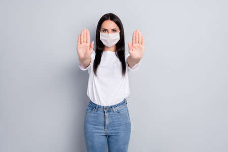Portrait of nice attractive content serious straight-haired girl showing stop sign solution health quarantine measure contact clean wash hands isolated on light grey pastel color background Banque d'images