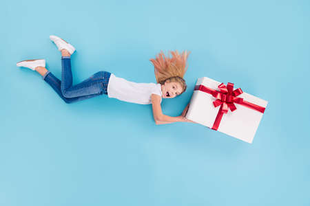 Top above high angle view profile side full size photo crazy excited girl kid hold big gift boxes imagine she fly supergirl hero deliver present 8-march holiday isolated blue color background Stock Photo
