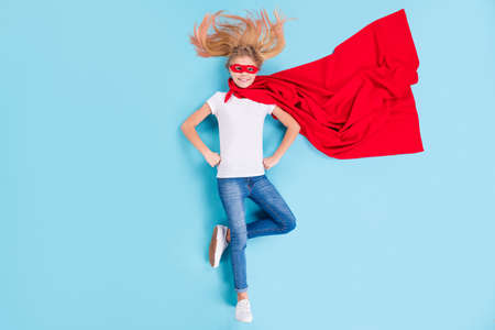 Top above high angle view full body photo of best powerful kid girl little super hero superwoman lay ready save world have red cape mask isolated over blue color background