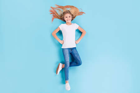 Top above high angle view fill length photo of sweet cute girl lay isolated over blue color background put hands waist wear stylish outfit