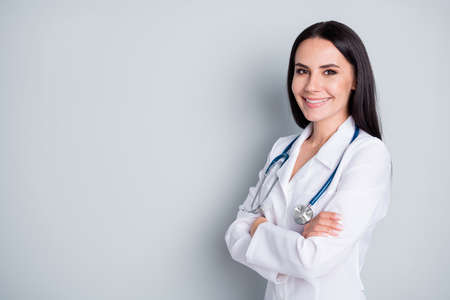 Profile photo of attractive doctor smiling reliable virology clinic arms crossed wear white lab coat stethoscope isolated grey color background Stock Photo