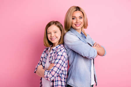 Positive cheerful team family mother daughter stand back to back cross hands ready decide solution decision wear casual denim jeans checkered plaid shirt isolated pastel color background