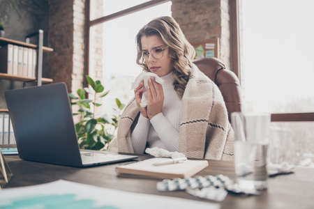 Portrait of her she nice attractive sick wavy-haired girl director blowing nose grippe therapy treatment career high fever in modern loft brick industrial interior style workplace workstation