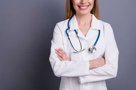 Cropped close-up portrait of her she nice attractive cheerful content blonde girl doc experienced specialist therapist folded arms assistance clinic isolated over grey violet pastel color background