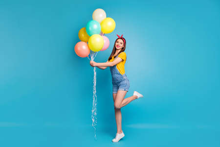 Full length body size view of her she nice attractive cheerful girl holding in hands bunch balls having fun isolated on bright vivid shine vibrant blue green teal turquoise color background