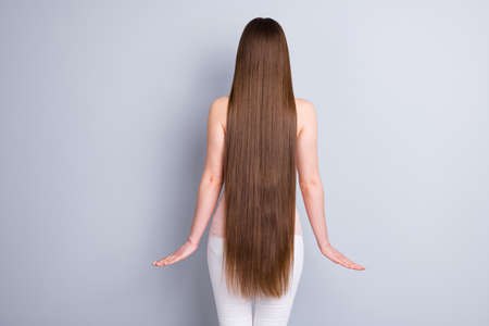 Rear back behind view photo of perfect model lady demonstrating, ideal neat long hairstyle after salon procedure wear singlet trousers isolated grey color background Imagens