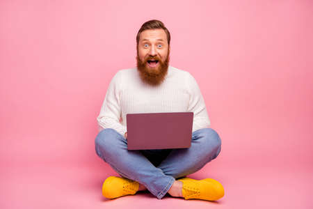 Full body photo astonished guy freelancer entrepreneur work laptop search social media discounts impressed scream wow omg wear good look sweater jeans isolated pastel color background Stock fotó
