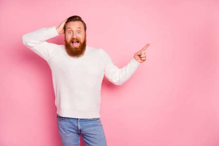Portrait of his he nice attractive amazed glad cheerful cheery red guy showing copy space advice decision like follow subscribe isolated over pink pastel color background Reklamní fotografie