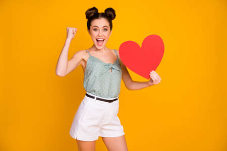 Positive ecstatic girl get big red paper card heart from famous university, cool guy on 14-february holiday raise fists scream yes wear white tank-top isolated bright shine color background