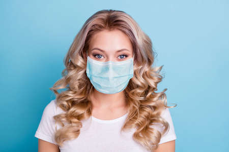 Close up photo beautiful amazing wonderful her she lady save covid-19 infection stay home have breating mask wearing casual white t-shirt clothes outfit isolated bright blue background